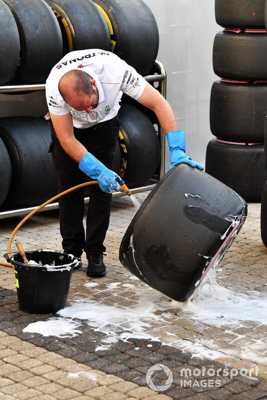 Mercedes AMG F1 mechanic washes Pirelli tyres