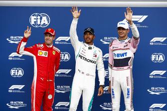 Sebastian Vettel, Ferrari, with Esteban Ocon, Racing Point Force India VJM1, and pole sitter Lewis Hamilton, Mercedes AMG F1