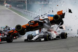 Fernando Alonso, McLaren MCL33 gets airbourne at the start of the race