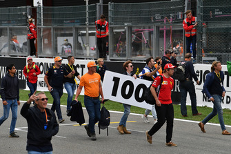 Fans on track with 100m marker board