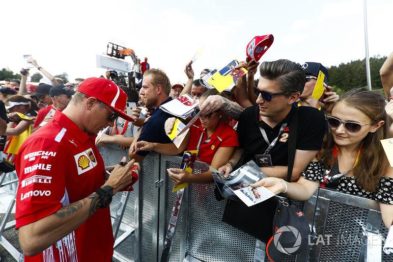 Kimi Raikkonen, Ferrari, signs autographs for fans