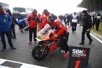 Alvaro Bautista, Aruba.it Racing-Ducati Team bike being wheeled off the grid after race1 cancellation