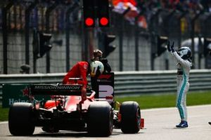 Valtteri Bottas, Mercedes AMG F1, celebrates pole as Sebastian Vettel, Ferrari SF90, arrives on the grid