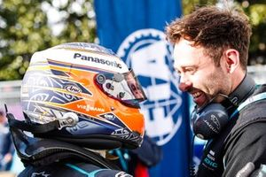 Mitch Evans, Panasonic Jaguar Racing, hugs a team member in parc ferme
