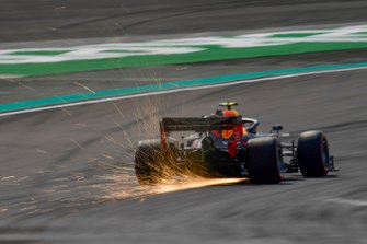Sparks kick up from the rear of Pierre Gasly, Red Bull Racing RB15