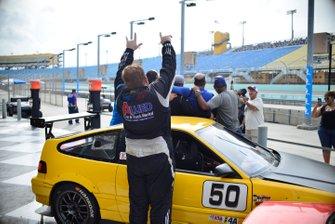 Sebastian Carazo photobombs the crew of the #50 MP4A Honda CRX driven by Jorge Gorbea of JAC Performance