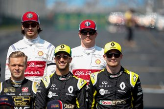 Antonio Giovinazzi, Alfa Romeo Racing and Kimi Raikkonen, Alfa Romeo Racing stand behind Kevin Magnussen, Haas F1, Daniel Ricciardo, Renault F1 Team, and Nico Hulkenberg, Renault F1 Team