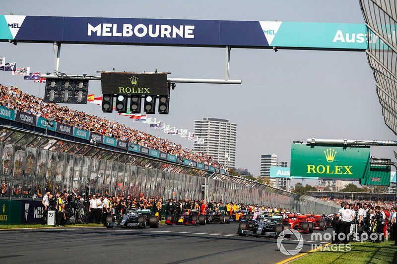 Lewis Hamilton, Mercedes AMG F1 W10, leads the field away at the start of the formation lap