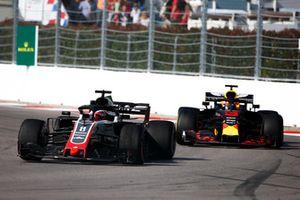 Romain Grosjean, Haas F1 Team VF-18, leads Daniel Ricciardo, Red Bull Racing RB14