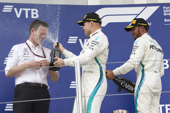 James Allison, Mercedes AMG F1 Technical Director, Valtteri Bottas, Mercedes AMG F1, Lewis Hamilton, Mercedes AMG F1 and celebrate on the podium with the champagne
