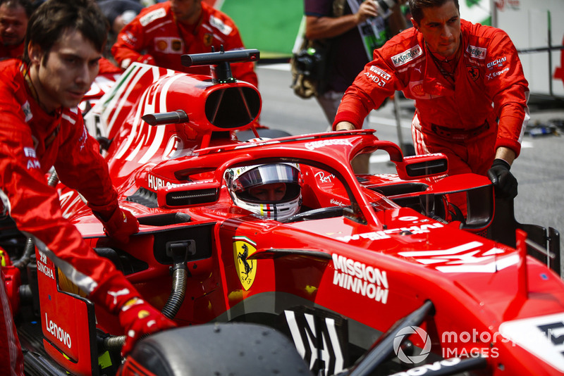 Sebastian Vettel, Ferrari, is pushed onto the grid.