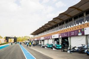 Teams prepare in the pit lane
