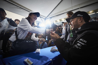 Lewis Hamilton, Mercedes AMG F1, signs an autograph