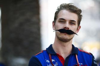 A Toro Rosso team member sports a flamboyant moustache