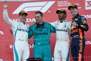 Lewis Hamilton, Mercedes AMG F1, on the podium with Valtteri Bottas, Mercedes AMG F1, and Max Verstappen, Red Bull Racing RB14