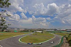 Esteban Ocon, Manor Racing; Nico Rosberg, Mercedes AMG F1