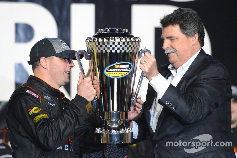 2016 Champion Johnny Sauter, GMS Racing Chevrolet is presented the trophy by NASCAR chairman Mike He