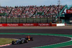 Valtteri Bottas, Mercedes-Benz F1 W08 and Max Verstappen, Red Bull Racing RB13 battle for position