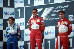 Podium: Race winner Michael Schumacher, Ferrari, second place Heinz-Harald Frentzen, Williams, third place Eddie Irvine, Ferrari