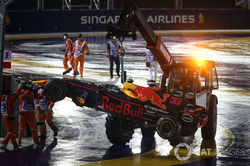 The car of Max Verstappen, Red Bull Racing RB13 is recovered by Marshals after crashing out at the s