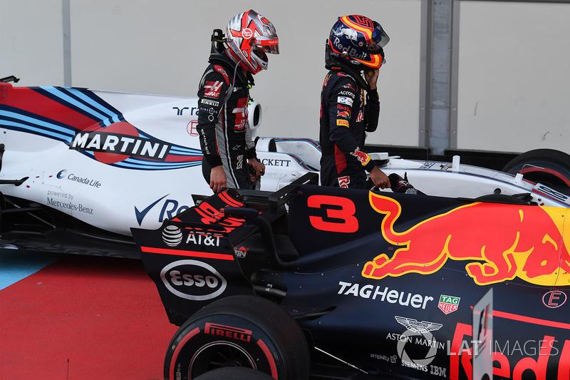 Kevin Magnussen, Haas F1 Team y Carlos Sainz Jr., Scuderia Toro Rosso in parc ferme