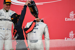 Daniel Ricciardo, Red Bull Racing and Lance Stroll, Williams celebrate on the podium, the champagne