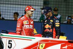 Обладатель поула Себастьян Феттель, Ferrari, и Даниэль Риккардо, Red Bull Racing