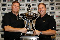 Jim Campbell and Mark Kent of Chevrolet with Manufacturers' Championship trophy