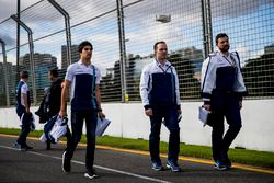 Williams team members walk the track with Lance Stroll, Williams
