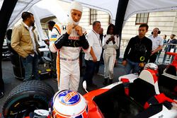 Jenson Button, McLaren, prepares to drive a 2 seat demo car