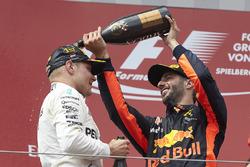 Third place Daniel Ricciardo, Red Bull Racing, pours Champagne on Race winner Valtteri Bottas, Merce