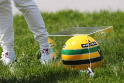 The genuine race worn Ayrton Senna crash helmet he was awarded by relatives of the late Brazilian racer, after matching his long standing career Pole position record of 65