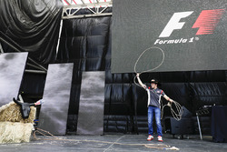 Santino Ferrucci, Haas F1 Team, tries his hand at the Lasso on the F1 stage
