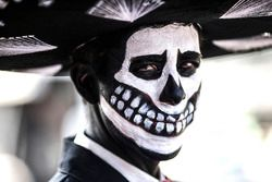 Day of the Dead-style costumes are worn in the paddock
