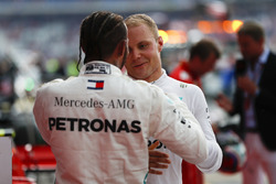 Race winner Lewis Hamilton, Mercedes AMG F1, and Valtteri Bottas, Mercedes AMG F1, celebrate in Parc Ferme