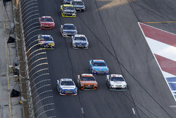 Ricky Stenhouse Jr., Roush Fenway Racing Ford, Daniel Suarez, Joe Gibbs Racing Toyota, Austin Dillon, Richard Childress Racing Chevrolet three-wide pass