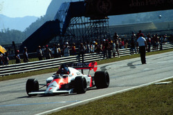Alain Prost, McLaren MP4/2, takes the checkered flag