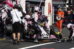 Sergio Perez, Force India VJM11, is pushed into the garage to retire from the race