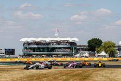Charles Leclerc, Sauber C37, leads Esteban Ocon, Force India VJM11, and Nico Hulkenberg, Renault Sport F1 Team R.S. 18