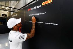 Lewis Hamilton, Mercedes AMG F1, signs the Pirelli hot lap board