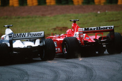 Juan Pablo Montoya, BMW Williams FW23; Michael Schumacher, Ferrari F1 2001