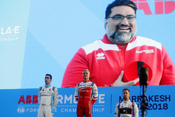Podium: Dilbagh Gill, CEO, Team Principal, Mahindra Racing, appears on the big screen as race winner