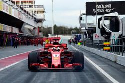 Jo Bauer, FIA Technical Delegate watches Sebastian Vettel, Ferrari SF71H in pit lane