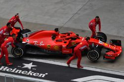 Ferrari mechanoics with Ferrari SF71H in pit lane