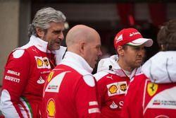 (L to R): Maurizio Arrivabene, Ferrari Team Principal with Jock Clear, Ferrari Engineering Director and Sebastian Vettel, Ferrari