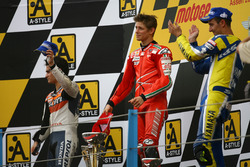 Podium: second place Dani Pedrosa; Winner Casey Stoner, Ducati; third place Colin Edwards, Yamaha