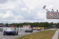 #25 Freedom Autosport Mazda MX-5: Stevan McAleer, Chad McCumbee takes the checkered flag
