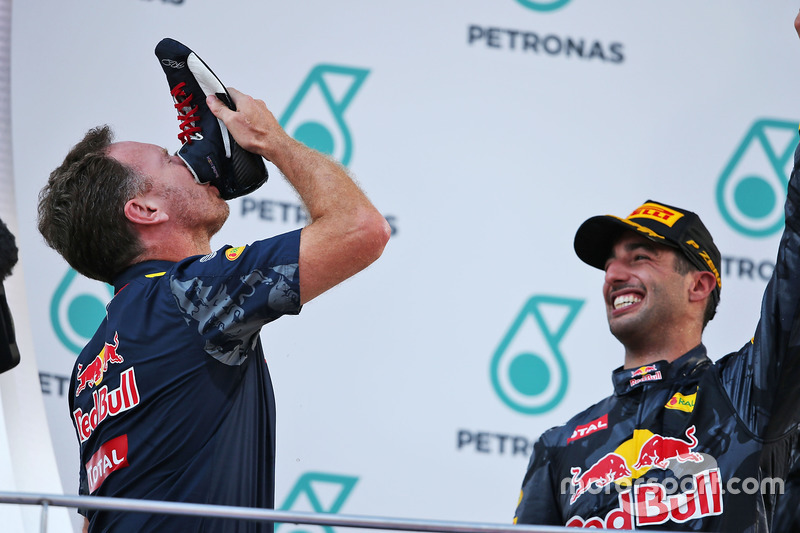 (L to R): Christian Horner, Red Bull Racing Team Principal celebrates on the podium by drinking champagne from the race boot of race winner Daniel Ricciardo, Red Bull Racing