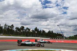 Nico Rosberg, Mercedes AMG F1 W07 Hybrid passes team mate Lewis Hamilton, Mercedes AMG F1 W07 Hybrid