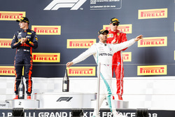 Max Verstappen, Red Bull Racing, 2nd position, Lewis Hamilton, Mercedes AMG F1, 1st position, Kimi Raikkonen, Ferrari, 3rd position, celebrate on the podium